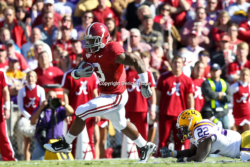 November 6, 2010; Baton Rouge, LA, USA;  Alabama Crimson Tide running back Trent Richardson (3) escapes a tackle by LSU Tigers linebacker Ryan Baker (22) during the first half at Tiger Stadium.  Mandatory Credit: Derick E. Hingle