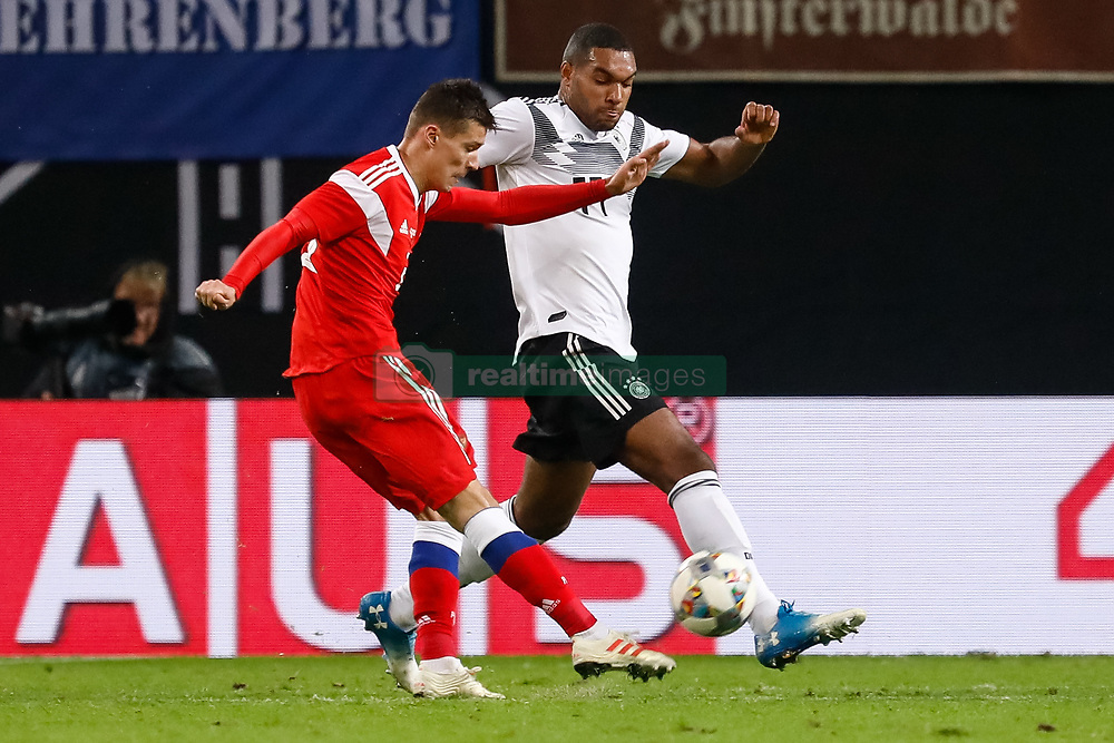 November 16, 2018 - Leipzig, Germany - Jonathan Tah (R) of Germany defends as Dmitri Poloz of Russia shoots on goal during the international friendly match between Germany and Russia on November 15, 2018 at Red Bull Arena in Leipzig, Germany. (Credit Image: © Mike Kireev/NurPhoto via ZUMA Press)