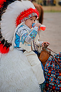 Crow Fair Parade, kids, headdress, baby bottle, Crow Fair Parade, Crow Indian Reservation, Montana