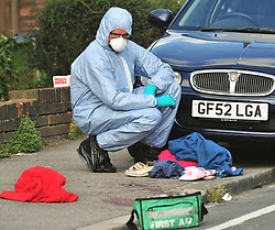© Licensed to London News Pictures. 19/08/2018<br /> New Eltham, UK. Police forensics stand over blood covered clothing at the scene of a Hammer attack on two women in New Eltham, south east London. Police are currently searching for 27 year old Joe Xuereb in connection with the attack. <br /> Photo credit: Grant Falvey/LNP