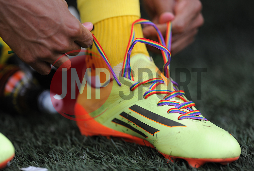 Norwich's Josh Murphy ties up his boots with rainbow laces on. - Photo mandatory by-line: Alex James/JMP - Mobile: 07966 386802 30/08/2014 - SPORT - FOOTBALL - Cardiff - Cardiff City stadium - Cardiff City  v Norwich City - Barclays Premier League
