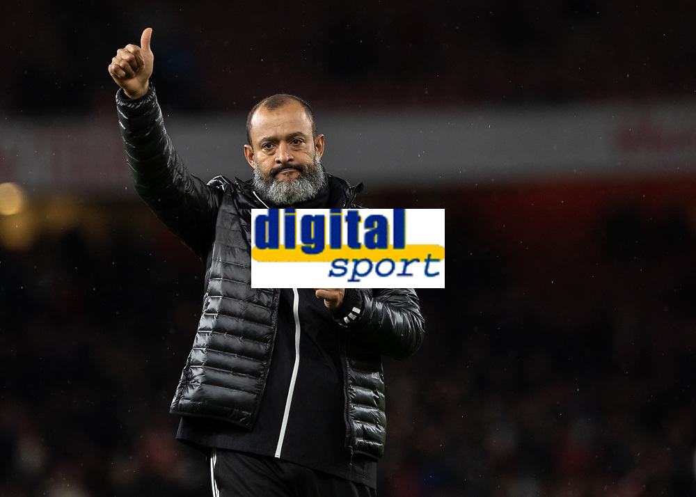 Football - 2019 / 2020 Premier League - Arsenal vs. Wolverhampton Wanderers<br /> <br /> Nuno Esoirito Santo, Manager of Wolverhampton Wanderers,  acknowledges the travelling fans at The Emirates Stadium.<br /> <br /> COLORSPORT/DANIEL BEARHAM