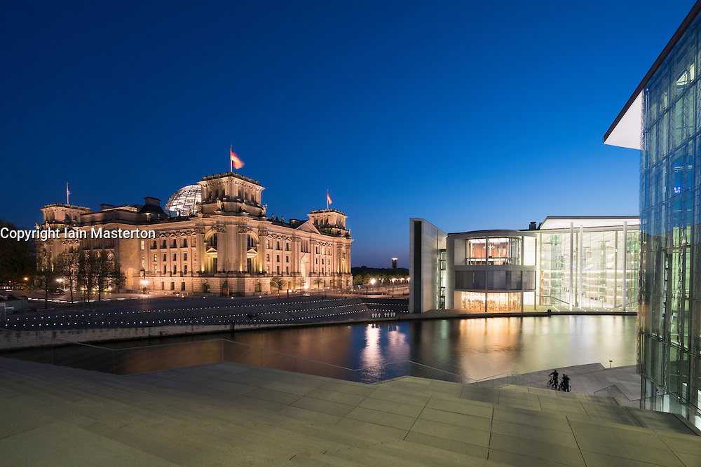 Night view of The Reichstag parliament building ,Paul Lobe Haus and Marie Elisabeth Luders ( Lueders) Haus government buildings beside River Spree in Berlin Germany
