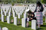 Staff Sergeant James E. Fisher III is comforted by his fiancé Nefertiti Staples as he visits the gravesite of his grandfather James E. Fisher on Memorial Day at Abraham Lincoln National Cemetery in Elwood, Ill., on Monday, May 26, 2014.