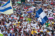 Crowds estimated at 380,00 gathered at San salvador's Plaza Salvador del Mundo ( Savior of the World ) as El Salvador celebrated a ceremony and mass announcing the beatification of Archbishop Oscar Romero. The Archbishop was slain at the alter of his Church of the Divine Providence by a right wing gunman in 1980. Oscar Arnulfo Romero y Galdamez became the fourth Archbishop of San Salvador, succeeding Luis Chavez, and spoke out against poverty, social injustice, assassinations and torture. Romero was assassinated while offering Mass on March 24, 1980.