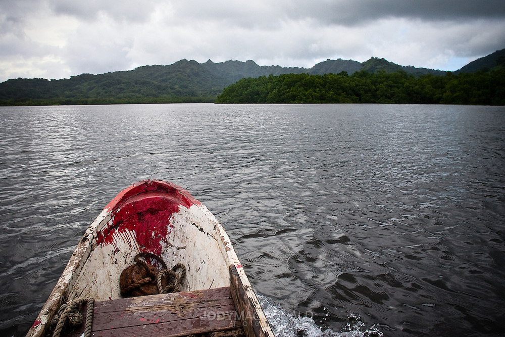 Fishing boat returns from a day at sea to the cloaked mysterious island of Kosrae in the heart of Micronesia.