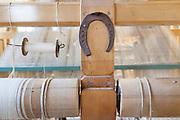 Soveria Mannelli (CZ). &shy;Lanificio Leo<br /> Telaio Jacquard manuale. Un antico ferro di cavallo &egrave; posto sulla macchina a protezione del lavoro e della produzione