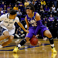 Mar 26, 2013; Baton Rouge, LA, USA; LSU Tigers guard Danielle Ballard (32) is guarded by Penn State Lady Lions guard Dara Taylor (2) in the first half during the second round of the 2013 NCAA womens basketball tournament at Pete Maravich Assembly Center. Mandatory Credit: Derick E. Hingle-USA TODAY Sports