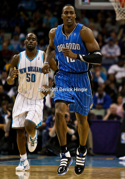 Feb 26, 2010; New Orleans, LA, USA; Orlando Magic center Dwight Howard (12) on the court during the second half against the New Orleans Hornets at the New Orleans Arena. The Hornets defeated the Magic 100-93. Mandatory Credit: Derick E. Hingle-US PRESSWIRE