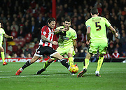 Brentford midfielder Sam Saunders driving into the box during the Sky Bet Championship match between Brentford and Huddersfield Town at Griffin Park, London, England on 19 December 2015. Photo by Matthew Redman.