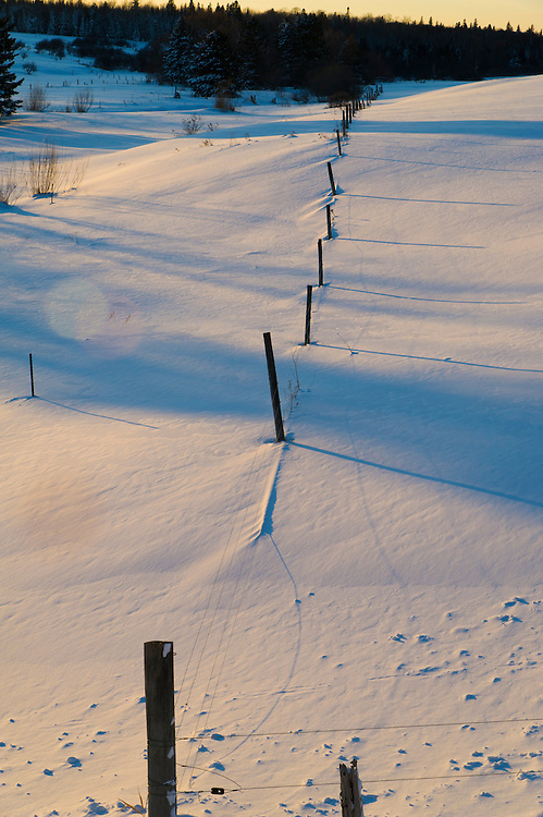A snowy farm field in winter on Michigan's Upper Peninsula.