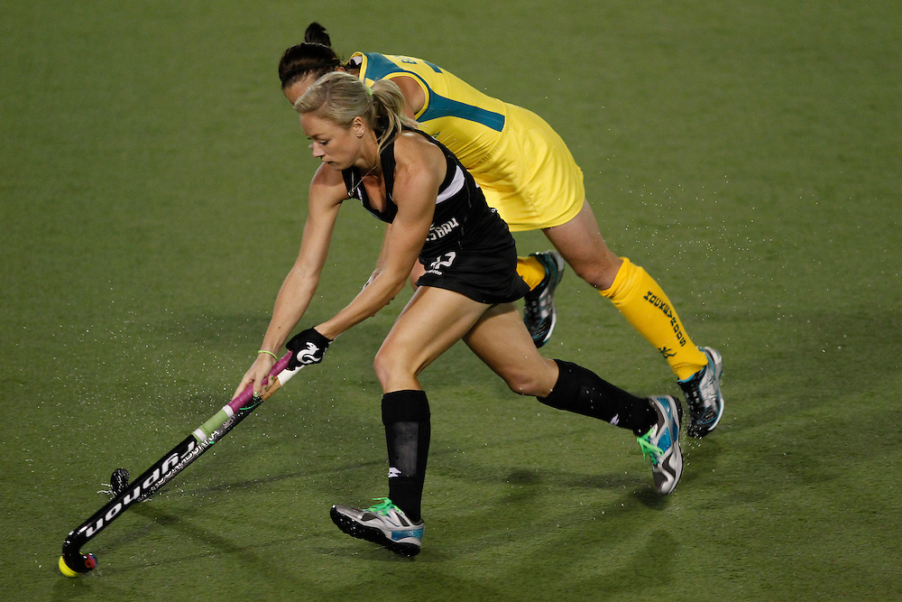 New Zealand's Anita Punt takes on Australia's Madonna Blyth during their four nations hockey final at North Harbour Hockey Stadium, Auckland, New Zealand, Monday, April 16, 2012. Credit:SNPA / Ben Campbell..