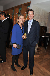 ALEX & CAROLINE ILLINGWORTH at the Linley Christmas party at Linley, 60 Pimlico Road, London on 20th November 2012.