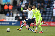 Preston North End Midfielder Adam Reach (32) gets away from Brighton central midfielder, Beram Kayal (7) during the Sky Bet Championship match between Preston North End and Brighton and Hove Albion at Deepdale, Preston, England on 5 March 2016.