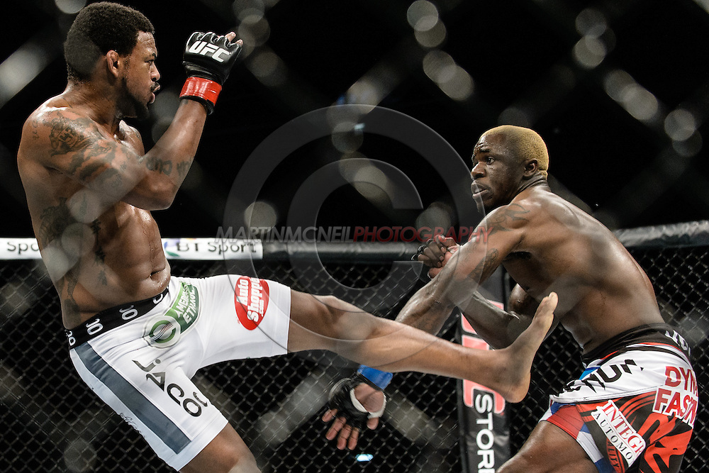 "LONDON, ENGLAND, MARCH 8, 2014: Melvin Guillard Michael Johnson during ""UFC Fight Night: Gustafsson vs. Manuwa"" inside the O2 Arena in Greenwich, London on Saturday, March 8, 2014 (© Martin McNeil)"