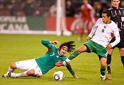 February 24, 2010; San Francisco, CA, USA;  Bolivia midfielder Walter Velzaga (8) avoids a slide tackle from Mexico midfielder Braulio Luna (7) during the first half at Candlestick Park. Mexico defeated Bolivia 5-0.
