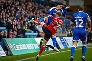 Gillingham FC defender Alfie Jones  (14) and Lincoln City midfielder Jake Hesketh (28) during the EFL Sky Bet League 1 match between Gillingham and Lincoln City at the MEMS Priestfield Stadium, Gillingham, England on 16 November 2019.