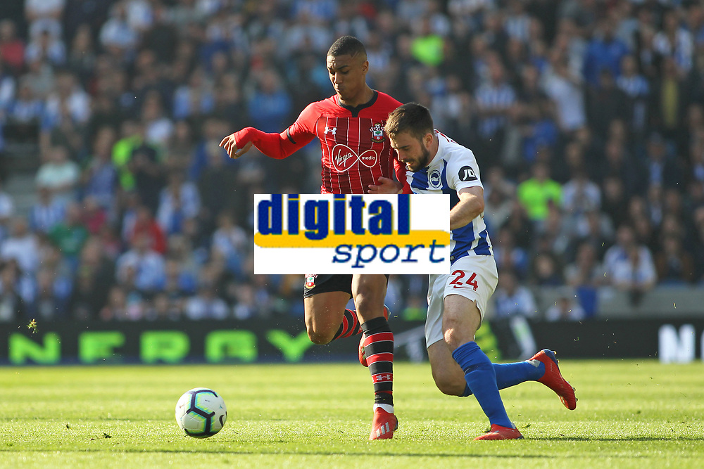 Football - 2018 / 2019 Premier League - Brighton and Hove Albion vs. Southampton<br /> <br /> Southampton's Yan Valery steps across Davy Propper of Brighton to stop a first half attack at The Amex Stadium Brighton <br /> <br /> COLORSPORT/SHAUN BOGGUST