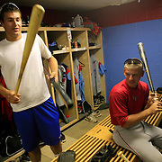 Chase Greening, left, and Ryan Peterson discuss hitting in the Clarinda A's locker room prior to their game with the Omaha Diamond Spirit in July. photo by David Peterson