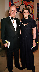 SIR TREVOR & LADY CHINN at a dinner in London<br />  on 23rd May 2000.OEL 52