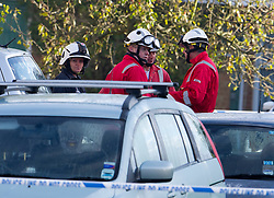 ©  London News Pictures. 15/10/2012. Harlow, UK. A fire investigation team at the scene on Barn Mead, Harlow, Essex where three children and a woman have died and three others are in hospital following a house fire. Two boys aged 13 and six, a girl aged 11 and the woman were declared dead at the scene. A nine-year-old boy and a three-year-old girl have serious burns and a man has minor burns. Photo credit : Ben Cawthra/LNP