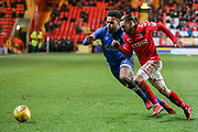 Aaron Holloway of Oldham Athletic and Ricky Holmes of Charlton Athletic during the EFL Sky Bet League 1 match between Charlton Athletic and Oldham Athletic at The Valley, London, England on 6 January 2018. Photo by Toyin Oshodi.