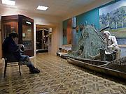 Aufseherin im jakutischen Staatsmuseum der Geschichte und Kultur der Bewohner des Nordens im Zentrum der Stadt Jakutsk. Jakutsk ist im Winter eine der kaeltesten Grossstaedte weltweit mit durchschnittlichen Winter Temperaturen von -40.9 Grad Celsius. Die Stadt ist nicht weit entfernt von Oimjakon, dem Kaeltepol der bewohnten Gebiete der Erde.<br /> <br /> Attendant in the United Yakutsk State Museum of History and Culture of People of the North. Yakutsk was founded in 1632 and celebrated 2007 the 375th anniversary. The museum showcases expositions on the regions nature, animal and plant life of taiga, forest-tundra, tundra and the Arctic zone of the republic, as well as the history of Yakutia from Palaeolith to present times.