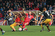 Cambridge United midfielder Harrison Dunk battles with York City midfielder Russell Penn during the Sky Bet League 2 match between York City and Cambridge United at Bootham Crescent, York, England on 3 October 2015. Photo by Simon Davies.