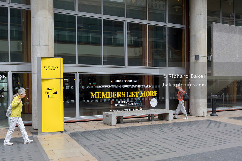 As visitors come and go outside the Royal Festival Hall on the Southbank an appeal for the benefits of membership to the Southbank Centre, on 2nd May 2019, in London, England.