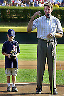 """Baseball Hall of Fame pitcher Jim Palmer (R) makes his remarks after giving the """"OxiClean True Grit"""" award to Evan McDaniel (L), who wrote the essay that won the contest for his team, and members his Leesburg, Virginia Little League team before the start of the Little League World Series Championship Game, Sunday, August 25, 2002, in South Williamsport, Pennsylvania. (Photo by William Thomas Cain/photodx.com)"""