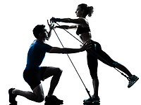 one caucasian couple man woman personal trainer coach exercising gymstick silhouette studio isolated on white background