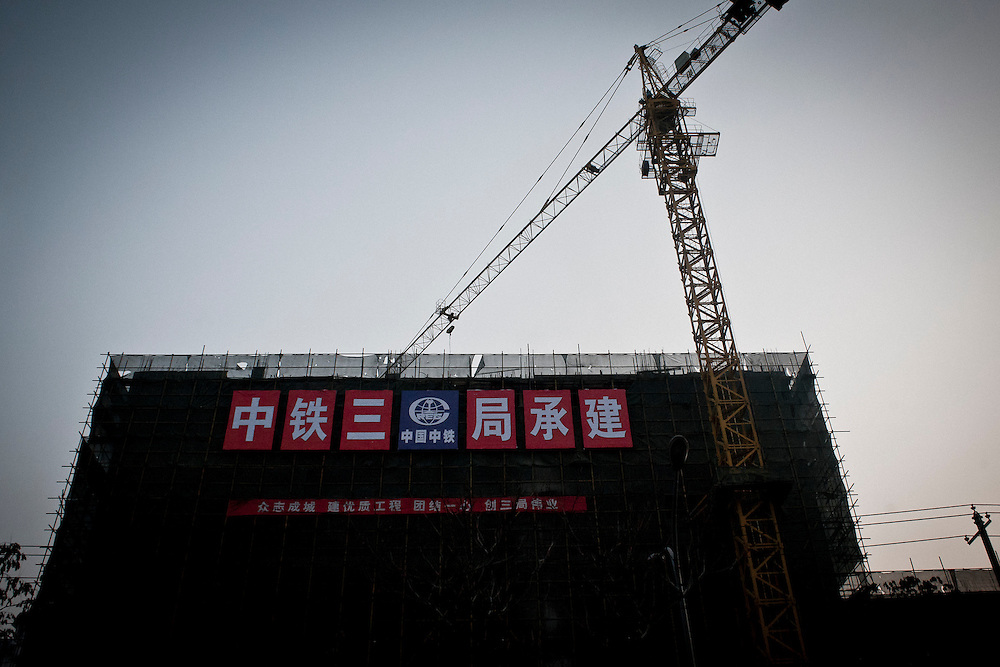 A construction site in Lanzhou near the Guo Jian electric factory. The authorities have tried to limit activity of construction during times of high pollution in winter but construction is one of the major sources of jobs in the province for thousands of migrants in Lanzhou, China.