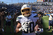 Sep 8, 2019; Carson, CA, USA; Los Angeles Chargers running back Austin Ekeler (30) celebrates after scoring on a 7-yard touchdown run in overtime against the Indianapolis Colts at Dignity Health Sports Park. The Chargers defeated the Colts 30-24 in overtime.