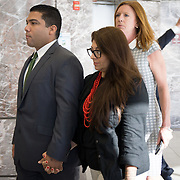 FORT LAUDERDALE, FLORIDA, DECEMBER 21, 2015<br /> Suspended Broward Sheriff's deputy Peter Peraza, left, and his wife Melinda, arrive to the Broward County Courthouse for a brief court appearance. Peraza faces manslaughter charges in the shooting death of Jermaine McBean, 33, in July of 2013.<br /> (Photo by Angel Valentin/Freelance).