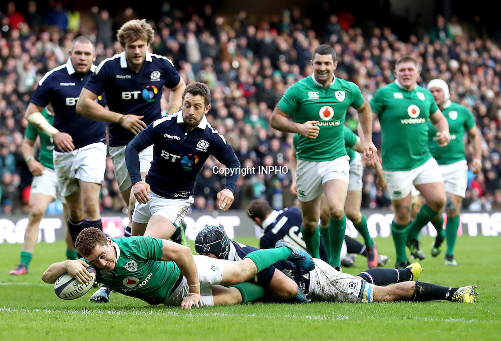 RBS 6 Nations Championship Round 1, BT Murrayfield, Scotland 4/2/2017<br /> Scotland vs Ireland<br /> Ireland's Paddy Jackson scores their third try despite Josh Strauss of Scotland<br /> Mandatory Credit &copy;INPHO/Dan Sheridan
