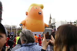 © Licensed to London News Pictures. 04/06/2019. London, UK. The Donald Trump baby blimp in parliament square this morning ahead of a protest against President Donald Trumps state visit to the UK. Photo credit: Andrew McCaren/LNP