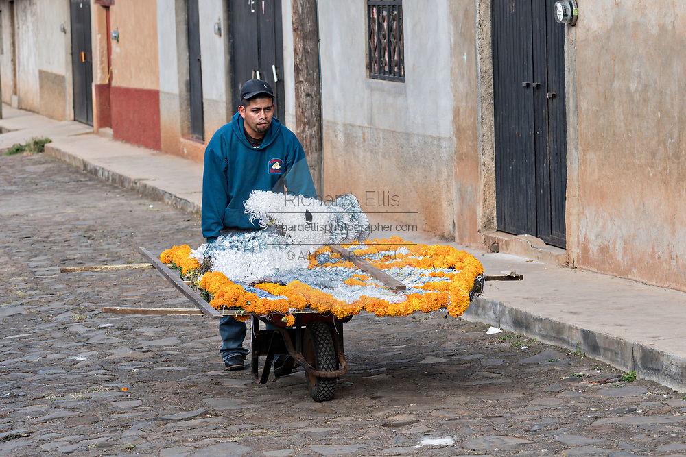 A Mexican man pushed a cart carrying an altar for the Day of the Dead festival October 31, 2017 in Tzintzuntzan, Michoacan, Mexico.
