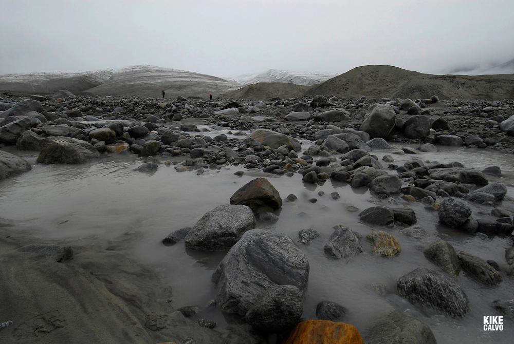 Sermilik Glacier. Sirmilik National Park. Bylot Island. Pond Inlet, Baffin Island. High Arctic. Canada<br /> ( isolated, remote, tourist, hike, hiking, foggy, weather, rock, rockly. tongue,.