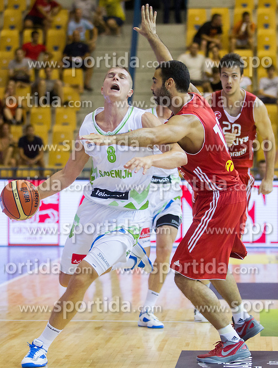 Edo Muric of Slovenia vs Cetin Serhat of Turkey during friendly match between National teams of Slovenia and Turkey for Eurobasket 2013 on August 4, 2013 in Arena Zlatorog, Celje, Slovenia. (Photo by Vid Ponikvar / Sportida.com)