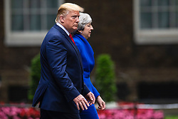© Licensed to London News Pictures. 04/06/2019. London, UK. President of the United States Donald Trump (L) and Prime Minister Theresa May  (R) leave 10 Downing Street before delivering a joint press conference. President Trump is in the UK for a three-day State Visit. Photo credit: Rob Pinney/LNP