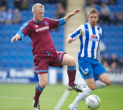 COLCHESTER, ENGLAND - Saturday, September 25, 2010: Tranmere Rovers'  Ryan Fraughan and Colchester United's Paul Reid in action during the League One match at the Colchester Community Stadium. (Photo by Gareth Davies/Propaganda)