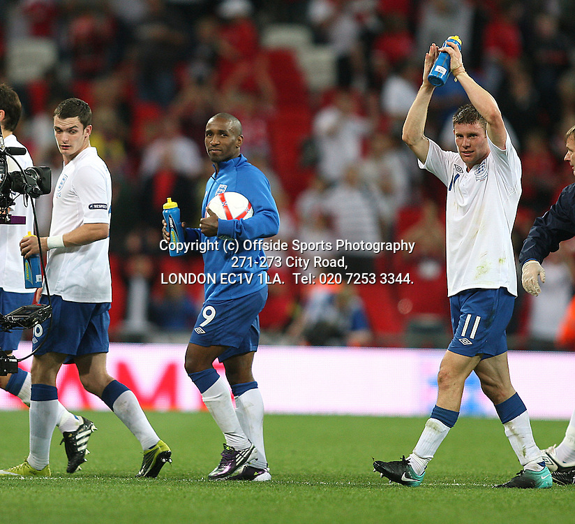 03/09/2010 International football. England v Bulgaria.<br /> Jermain Defoe walks off with the ball after his hat trick (3 goals) for England.<br /> Photo: Mark Leech.