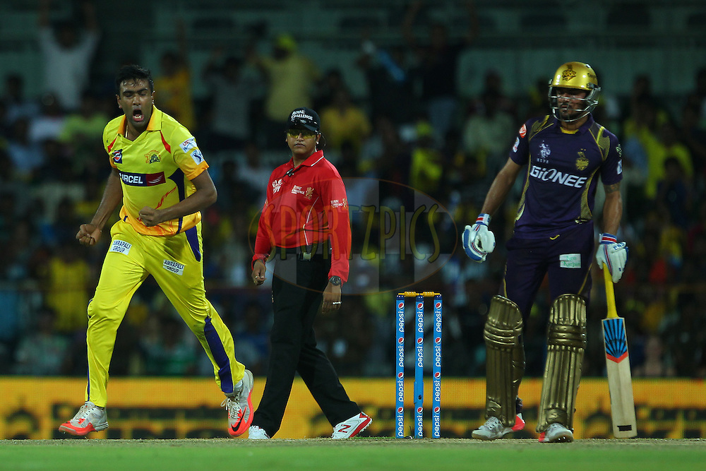 Ravichandran Ashwin of the Chennai Superkings celebrates the wicket of Robin Uthappa of the Kolkata Knight Riders  during match 28 of the Pepsi IPL 2015 (Indian Premier League) between The Chennai Superkings and The Kolkata Knight Riders held at the M. A. Chidambaram Stadium, Chennai Stadium in Chennai, India on the 28th April 2015.<br /> <br /> Photo by:  Ron Gaunt / SPORTZPICS / IPL
