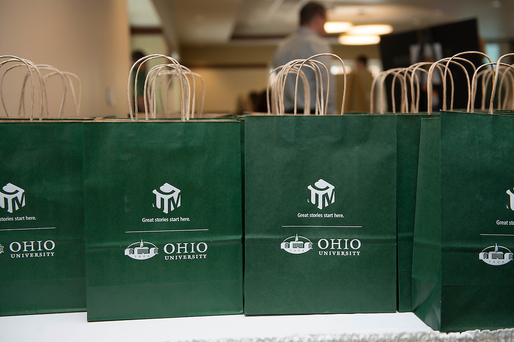 Expo Participants recieved a gift bag for attending the Campus Communicator Network Expo in Nelson Commons on Wednesday, May 11, 2016. © Ohio University / Photo by Kaitlin Owens