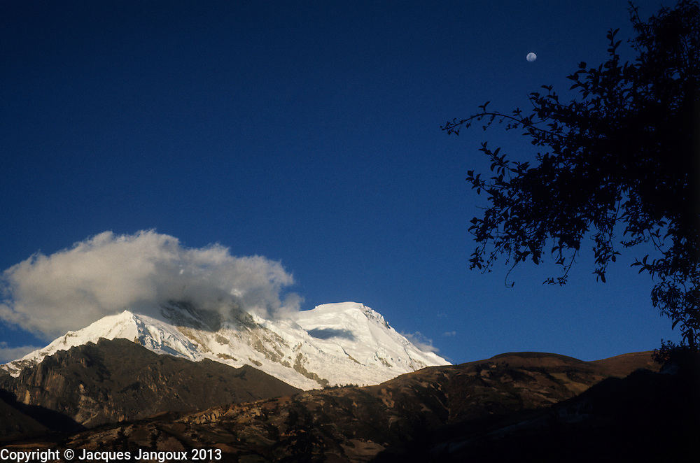 Peru, Andes Montain Range - Cordillera de los Andes, Cordillera Blanca mountain range, last rays of sun on snow-covered Mount Huascarán (6768 m), highest mountain in Peru, with moon rising.