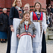 Three weeks aboard the Kong Harald. Hurtigruten, the Coastal Express. Bergen. Family in tradionnal clothes.