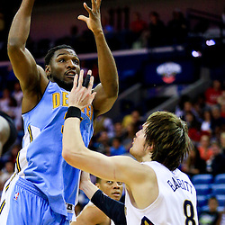 Mar 31, 2016; New Orleans, LA, USA; Denver Nuggets forward Kenneth Faried (35) shoots over New Orleans Pelicans forward Luke Babbitt (8) during the second quarter of a game at the Smoothie King Center. Mandatory Credit: Derick E. Hingle-USA TODAY Sports