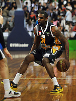 Riki Buckrell dribbles, in the NBL match, between the Otago Nuggets and Hawkes Bay, Lion Foundation Arena, Edgar Centre, Dunedin, Otago, New Zealand, Friday, May 24, 2013. Credit: Joe Allison / Allison Images.