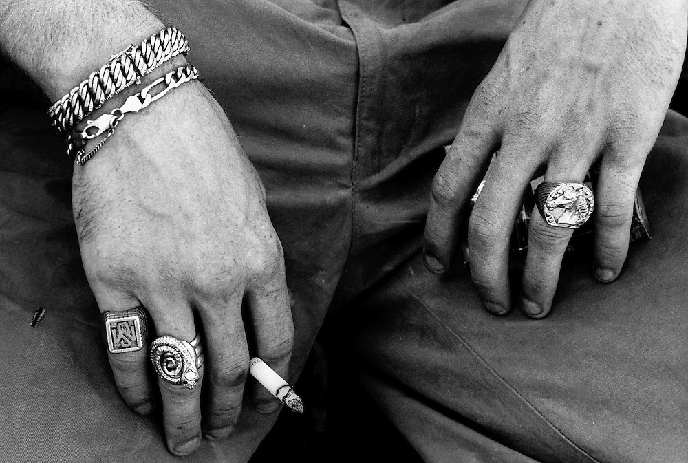 "Hands of a gypsy holding a cigarette. France, Marville, August 2002 - 40,000 Gypsies from all over the Europe come together and pray in Marville, a little village in France. They encamped in a former air base of NATO during 1 week. ""Vie et Lumiere"" is an International Evangelic Community.©Jean-Michel Clajot / Cosmos"
