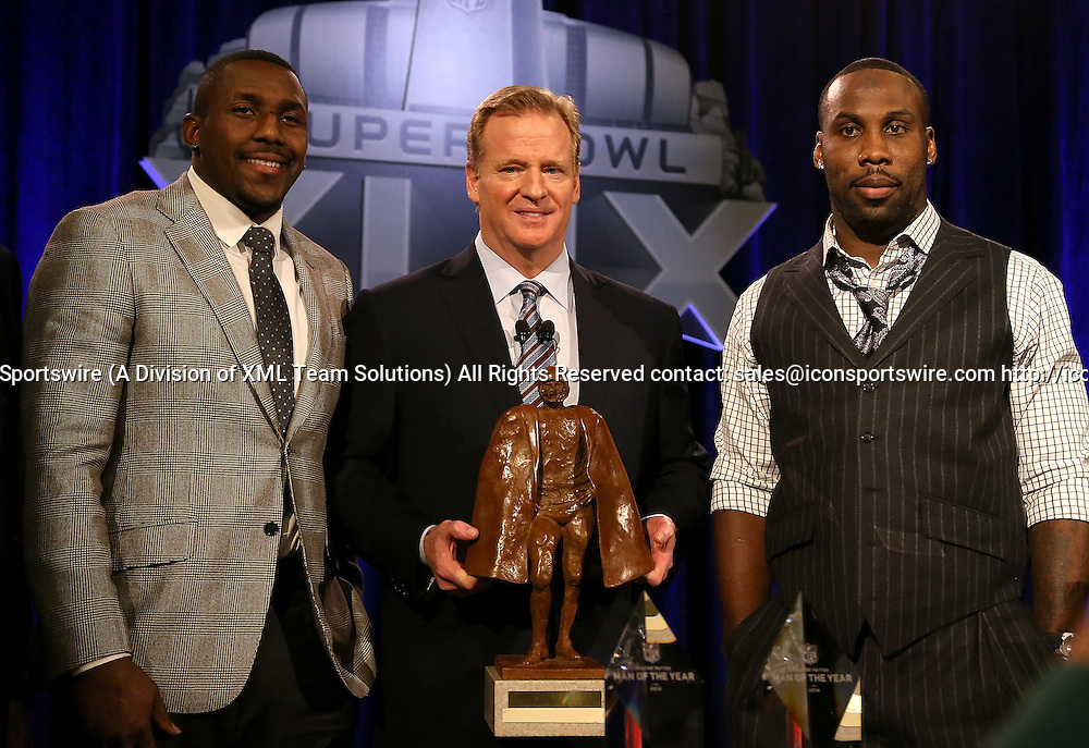 30 January 2015: NFL Commissioner Roger Goodell poses with Walter Payton Man of the Year finalists Anquan Boldin (right) of the San Francisco 49ers and Thomas Davis (left) of the Carolina Panthers  during the Super Bowl XLIX press conference at the Phoenix Convention Center in Phoenix, Az.
